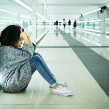 Sad girl sitting. Your brain on trauma Triune Thrapy Group Los Angeles, CA.