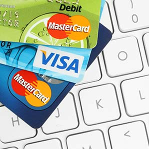 Credit cards on keyboard. Online shopping concept. Compulsive behaviors treatment and therapy Los Angeles, CA
