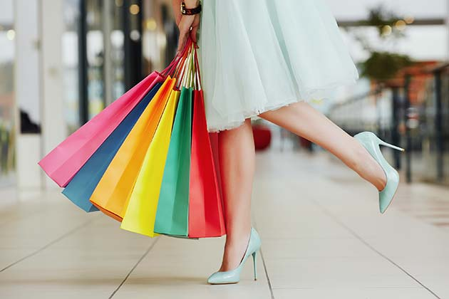 Girl in shopping mall with bags.
