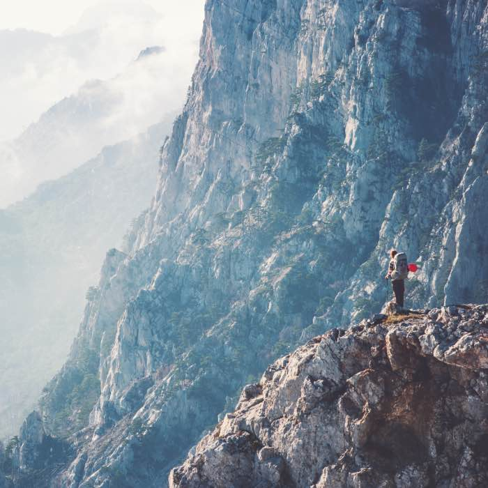 Woman traveler on cliff.