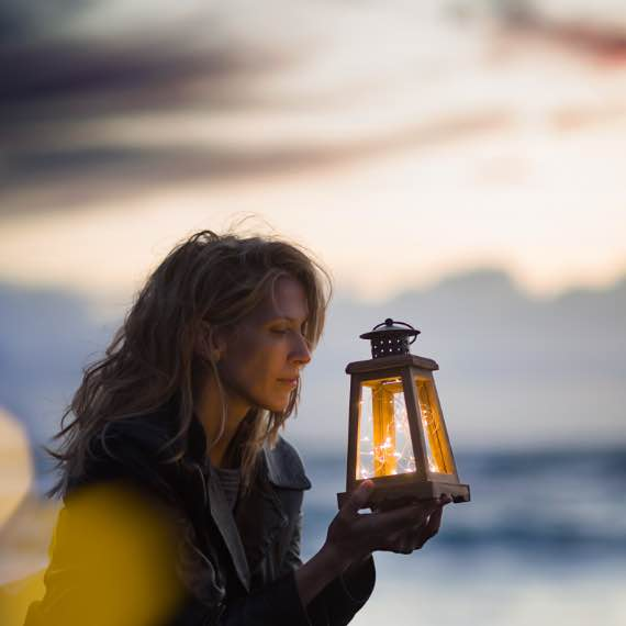 Woman with lantern.