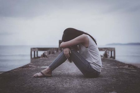 Lonely, young woman in depression.